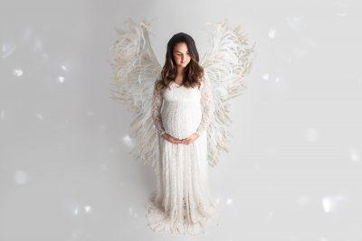 Babybauchshooting mit weißem Kleid